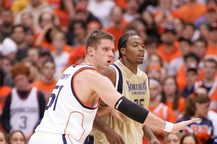 Craig Forth, left, guards his man during an SU basketball game.