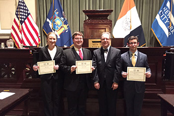 The College of Law's moot court team, from left: Amy Doan, Kevin Braddock Smith, Professor Richard Risman and David Katz