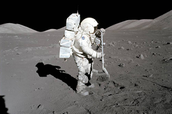 Scientist-astronaut Harrison Schmitt, Apollo 17 lunar module pilot, collects lunar samples. (Image: NASA 1972)