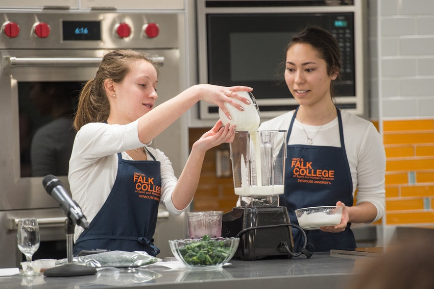 Two students preparing a recipe
