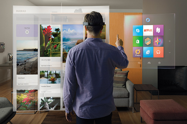 A user operates a HoloLens system.