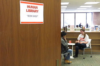 "A borrower interviews a ""human book"" from last year's Human Library."