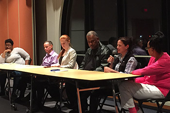 Community activists speak during an Impact Week panel.