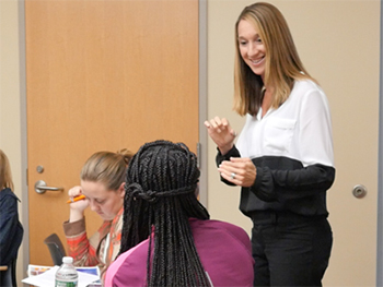Research associate Julia Snyder training a new class of biology peer leaders.