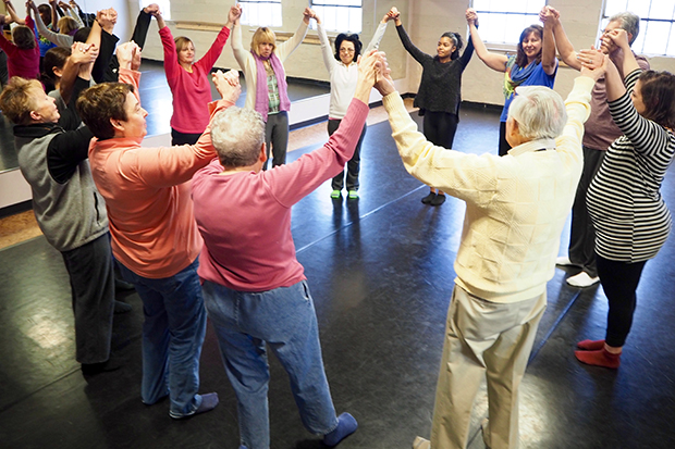 People with Parkinson's Disease, caregivers and others take part in a Moving through Parkinson's class.