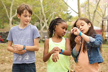 Kid Power participants take a look at their activity trackers.