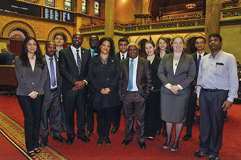 LL.M. students pose with State Assemblywoman Pamela Hunter, center, during their visit to Albany.