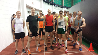 Syracuse Noontime Runners race start in Manley Field House. One of the runners is Chancellor Kent Syverud, at left in black T-shirt. (Photo courtesy of Patti Ford, budget manager in the Department of Physics and co-commissioner of the league)