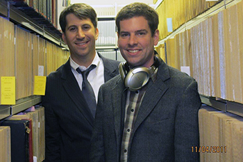 "Jim O'Connor, left, and ""Sound Beat"" announcer Brett Barry in the stacks at the Belfer Archive."