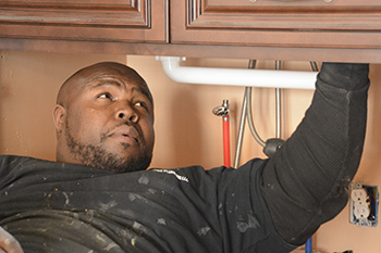 NaDonte Jones, the only black master plumber in Syracuse, started his own business three years ago. He struggles to expand the business, but is optimistic.