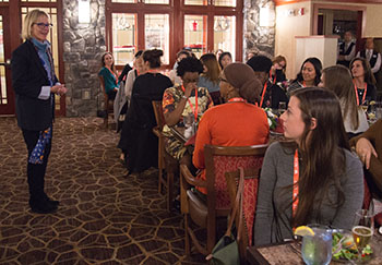 """Dean Anne Clarke addresses the """"Closing the Gap"""" women's retreat on professional practices in the visual arts."""