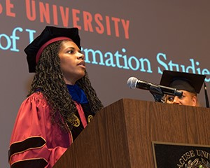 Renee Hill accepts her award at the graduate convocation.
