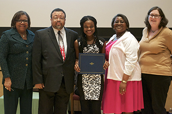 Charnice Milton Award Winner Ashley McBride, center, with, from left, Newhouse Dean Lorraine Branham; Milton father, Ken McClenton; Milton's mother, Francine Milton; and Associate Professor Aileen Gallagher