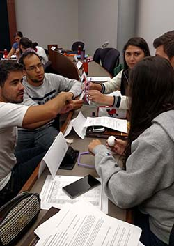 Brazilian students apply their project management skills to solve problems and engage in team building.