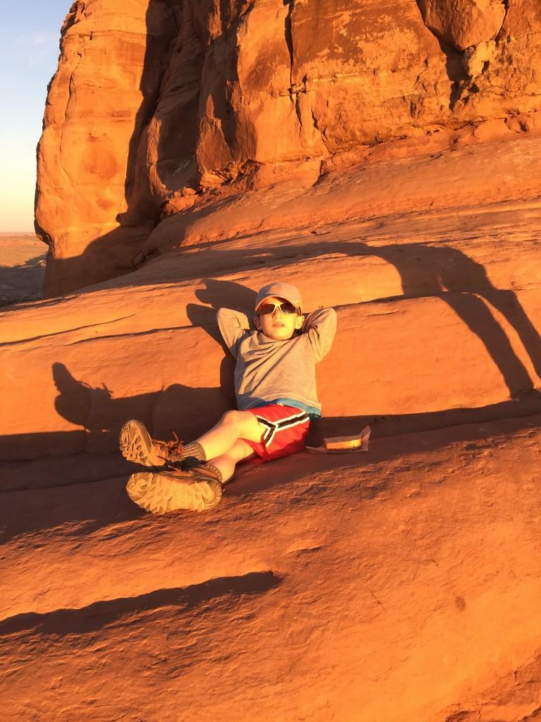 Boy resting on rocks