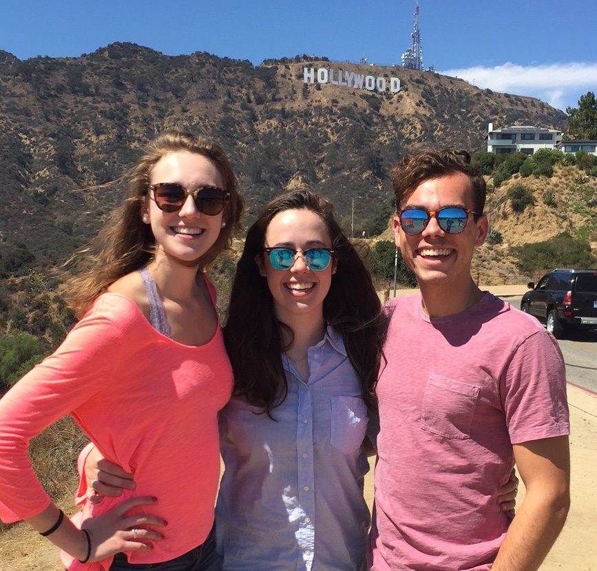 Three students in front of Hollywood Sign