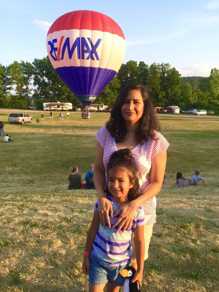 woman and child in front of hot air balloon