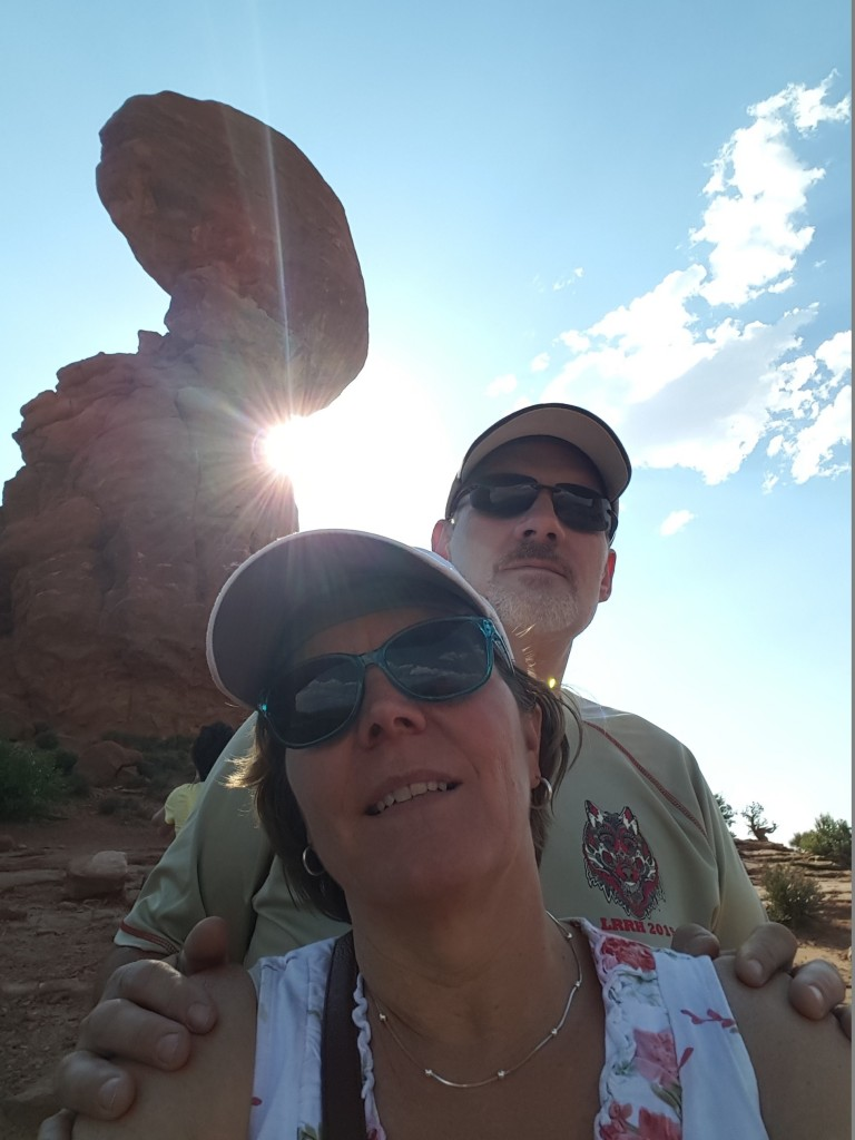 two people in front of rocky outcrop