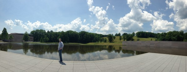 man in front of reflecting pool