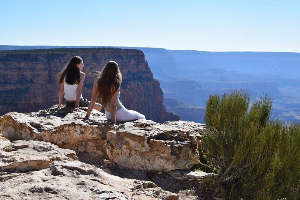 two women overlooking Grand Canyon