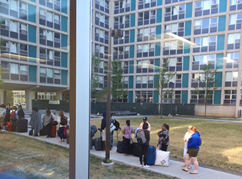 Summerstart students line up to enter Ernie Davis Residence Hall at the beginning of their six-week experience on campus.