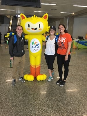 Students (from left) Christopher Henderson, Madeline Oleszkiewicz and Julie McCullough with Vinicius, the mascot of the 2016 Summer Olympics, at the Rio de Janeiro International Airport
