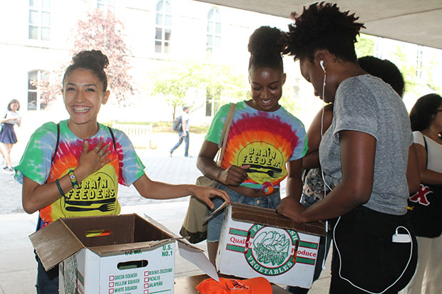 Food studies alumna Imelda Rodriguez '16 and food studies major Ashia Aubourg '18 work together in handing out CSA shares last fall.