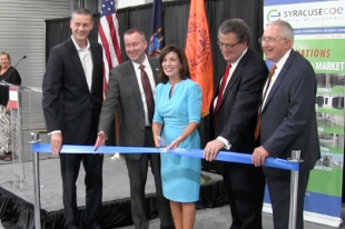 Lt. Gov. Kathy Hochul cuts the ribbon during ceremonies held at the Center of Excellence Building.