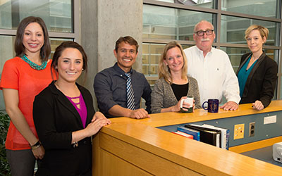The staff of the Lerner Center is currently (l-r) Leah Moser, assistant program director; Lerner Fellow Katie Wood; Roberto Martinez, coordinator of the Healthy Neighborhood project; Lerner Chair Cynthia Morrow; Faculty Director Tom Dennison; and Rebecca Bostwick, program director.