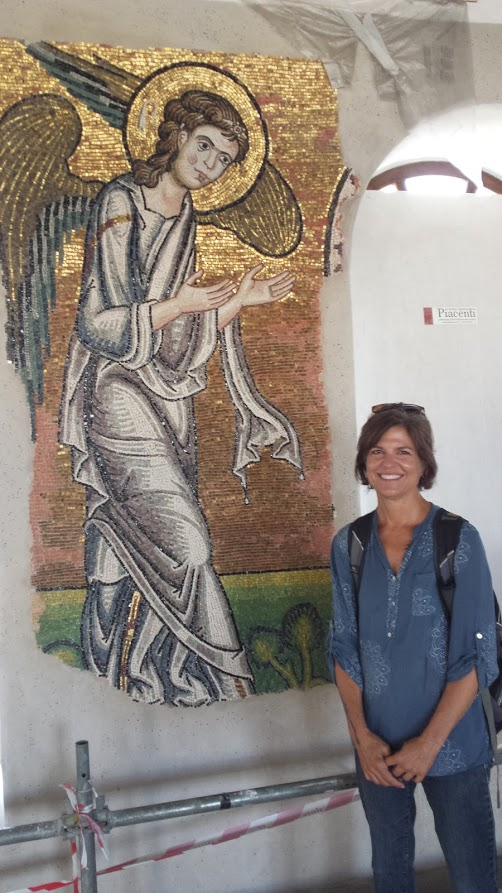 woman next to mosaic