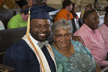 Tim Bryant with this mother, Sylvia Bryant, at his 2015 college commencement.