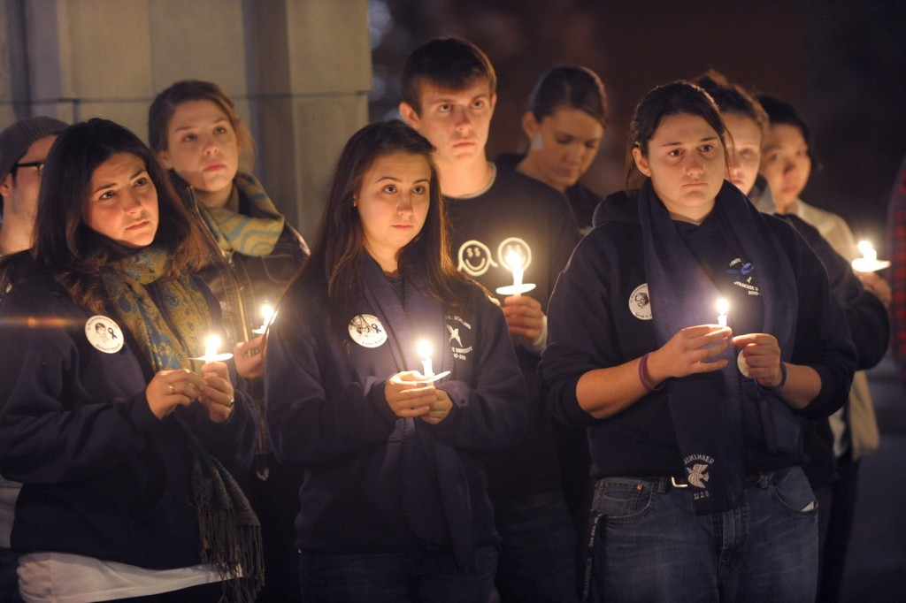 students holding candles