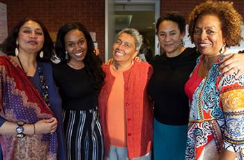 Chandra Talpade Mohanty (far left) and Linda Carty (far right) flank Syracuse graduate student Dellareese Jackson, Fielding professor Margo Okazawa-Rey and UC-Davis professor Amina Mama.