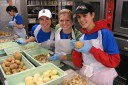 Students work in the kitchen of a nonprofit agency during a previous alternative Spring Break program.