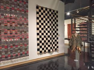 Items in the exhibition of West African textiles at the Syracuse University Art Galleries