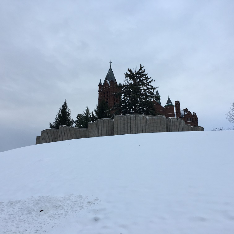 building on a snowy hill