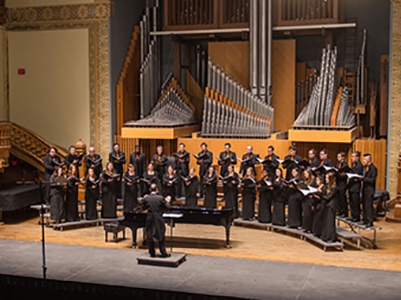 The University Singers performing in Setnor Auditorium