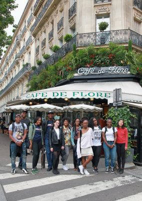 students in front of a cafe