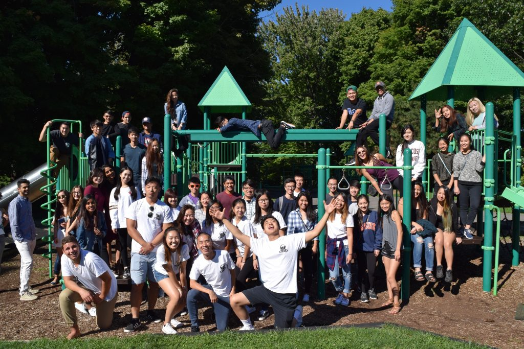 students in front of a playground set