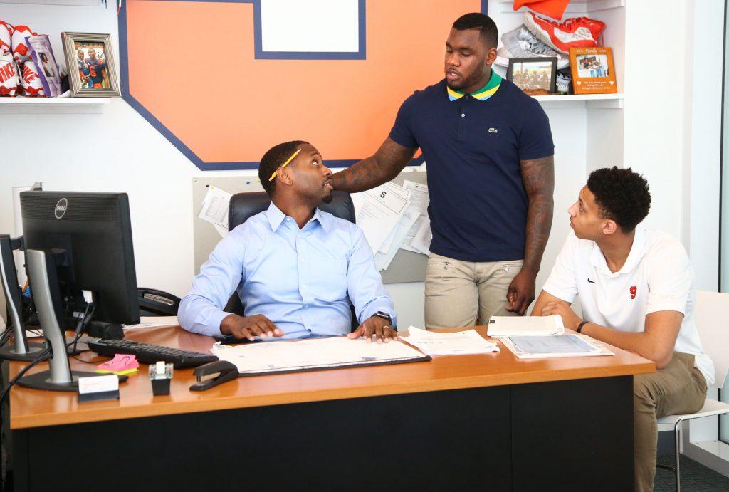 three people at desk