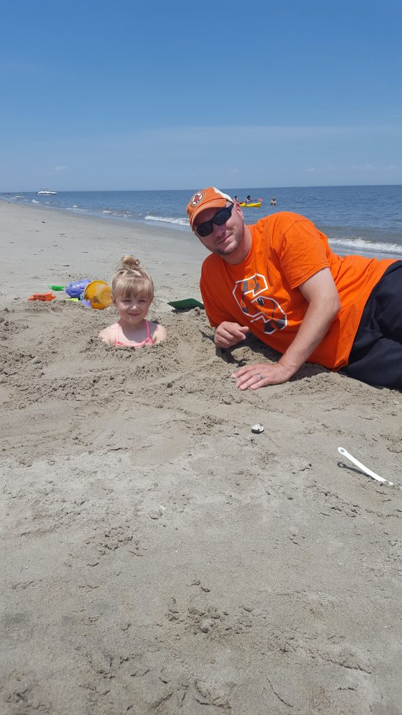 Chad Ames G'16, staff member in the Environmental Health & Safety Services Office, and his daughter Abby enjoy a family vacation at Broadkill Beach in Delaware.