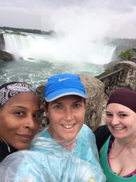 women in front of waterfalls