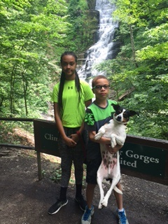 two children in front of waterfalls
