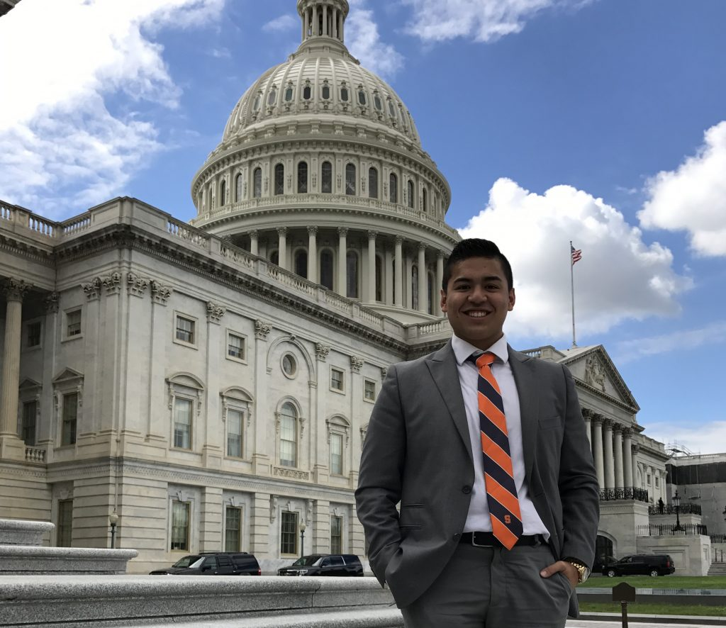 man in front of Capitol building