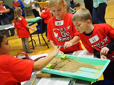 Children examine lesson