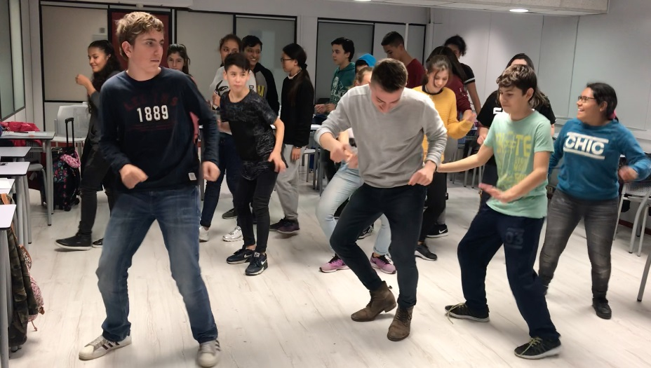 people dancing in a classroom