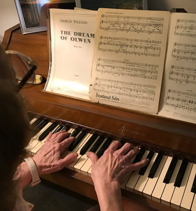 Thelma Bonzek playing piano