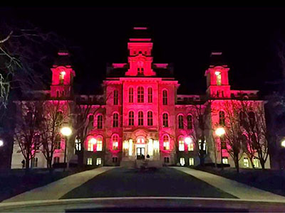 The Hall of Languages lit up in red