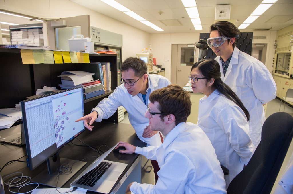 Carlos Castañeda (left), assistant professor of biology and chemistry, in his lab with (from left) graduate student Brian Martyniak, postdoc Thuy Dao and grad student Tongyin Zheng.