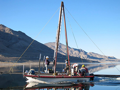 Sailboat on a lake with crew working